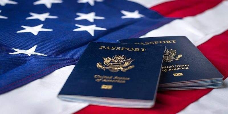 two blue passports on USA Flag