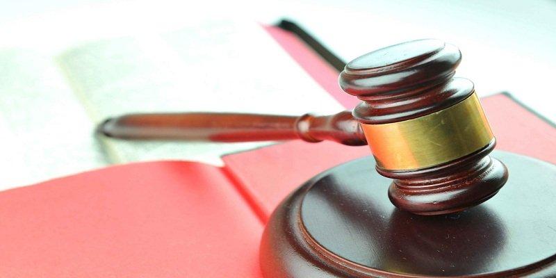 immigration document near Court Gavel on desk in blur background